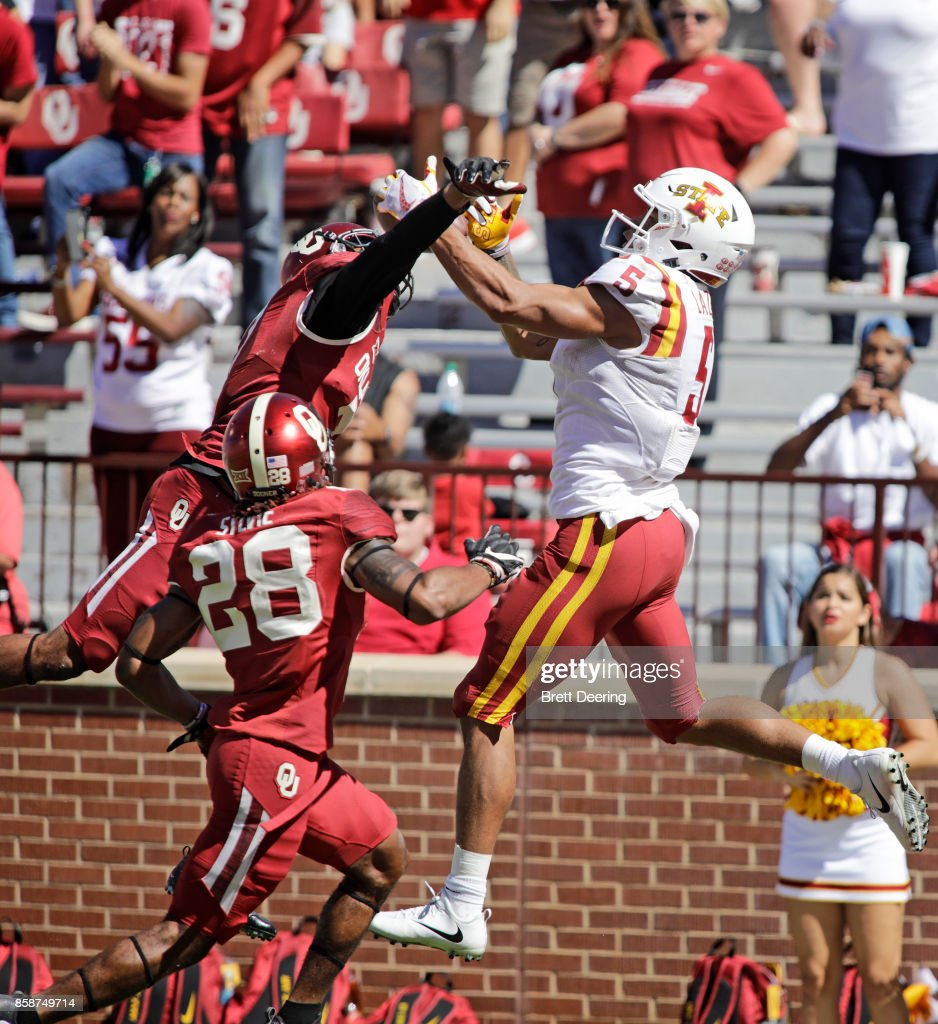 wide receiver Allen Lazard #5 of the Iowa State Cyclones catches a touchdown pass as cornerback Jordan Thomas #7 of the Oklahoma Sooners defends at Gaylord Family Oklahoma Memorial Stadium on October 7, 2017 in Norman, Oklahoma. Iowa State defeated Oklahoma 38-31.