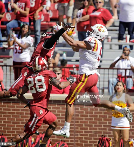 wide receiver Allen Lazard of the Iowa State Cyclones catches a touchdown pass as cornerback Jordan Thomas of the Oklahoma Sooners defends at Gaylord...