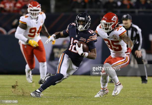 Wide receiver Allen Robinson of the Chicago Bears runs the ball against cornerback Charvarius Ward of the Kansas City Chiefs in the third quarter of...