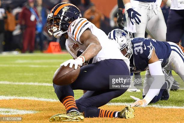 Wide receiver Allen Robinson of the Chicago Bears scores a touchdown over the defense of the Dallas Cowboys in the second quarter of the game at...