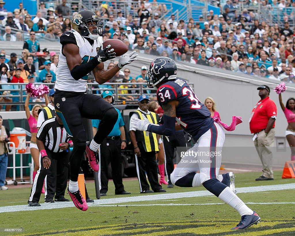 Wide Receiver Allen Robinson #15 of the Jacksonville Jaguars makes a touchdown catch over cornerback A.J. Bouye #34 of the Houston Texans during the game at EverBank Field on October 18, 2015 in Jacksonville, Florida. The Texans defeated the Jaguars 31 to 20.