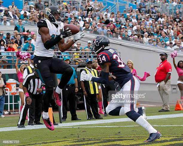 Wide Receiver Allen Robinson of the Jacksonville Jaguars makes a touchdown catch over cornerback A.J. Bouye of the Houston Texans during the game at...