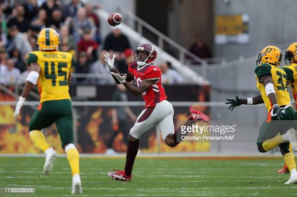 Wide receiver Alonzo Moore of the San Antonio Commanders makes a reception against the Arizona Hotshots during the first half of the AAF game at Sun...