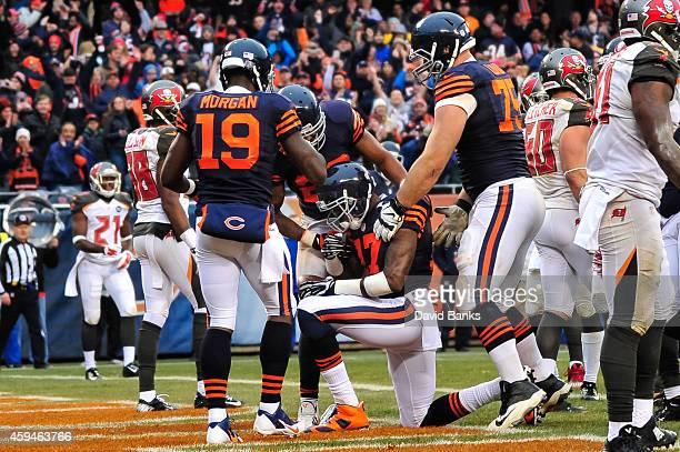 Wide receiver Alshon Jeffery of the Chicago Bears is surrounded by teammates after scoring in the third quarter against the Tampa Bay Buccaneers at...