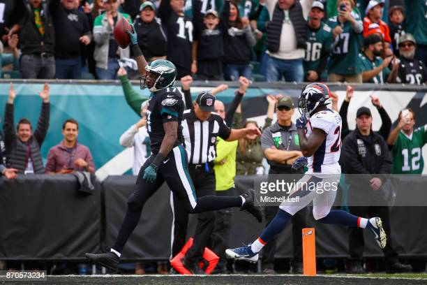 Wide receiver Alshon Jeffery of the Philadelphia Eagles scores a touchdown against free safety Darian Stewart of the Denver Broncos during the first...