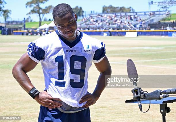 Wide receiver Amari Cooper of the Dallas Cowboys is interviewed by media during training camp at River Ridge Complex on August 3, 2021 in Oxnard,...