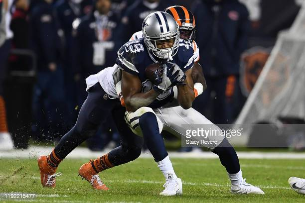 Wide receiver Amari Cooper of the Dallas Cowboys is tackled by defensive back Kevin Toliver of the Chicago Bears during the game at Soldier Field on...