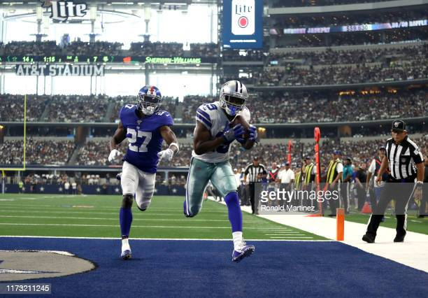 Wide receiver Amari Cooper of the Dallas Cowboys makes the recption for a touchdown in front of cornerback Deandre Baker of the New York Giants...