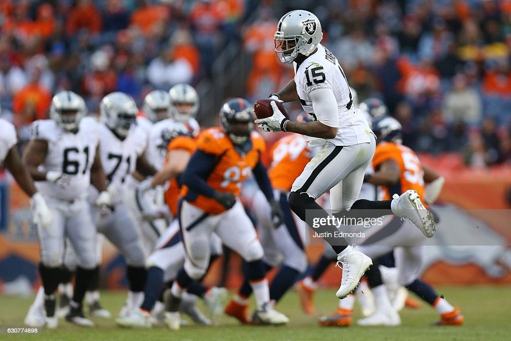 Wide receiver Amari Cooper #89 of the Oakland Raiders catches a pass in the third quarter of the game against the Denver Broncos at Sports Authority Field at Mile High on January 1, 2017 in Denver, Colorado.