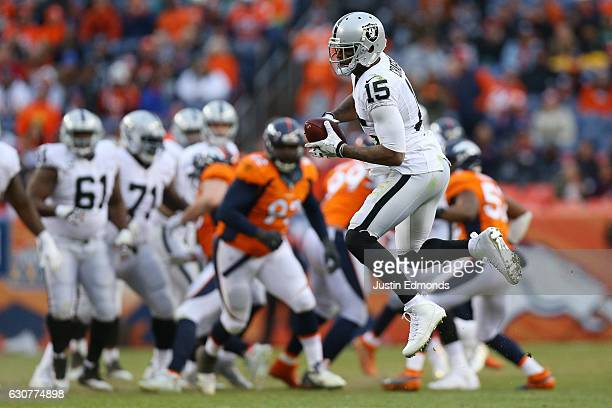 Wide receiver Amari Cooper of the Oakland Raiders catches a pass in the third quarter of the game against the Denver Broncos at Sports Authority...