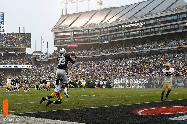 Wide receiver Amari Cooper of the Oakland Raiders catches a touchdown pass against cornerback Damarious Randall of the Green Bay Packers in the third...