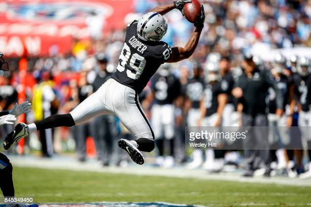 Wide receiver Amari Cooper of the Oakland Raiders makes a catch against the Tennessee Titans in the second half at Nissan Stadium on September 10...