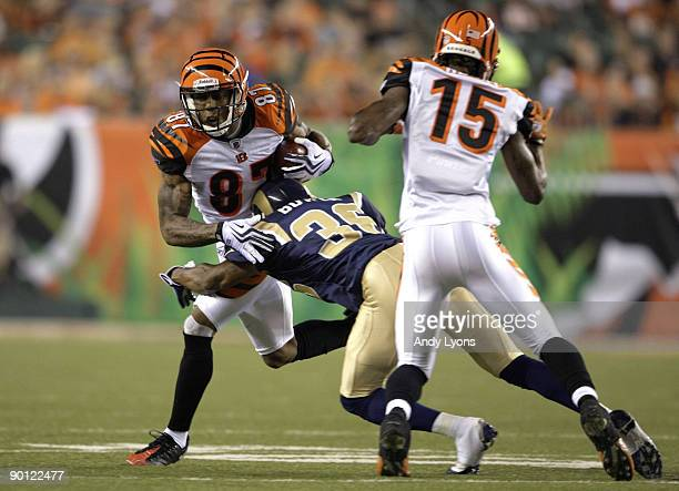 Wide receiver Andre Caldwell of the Cincinnati Bengals attempts to break the tackle of Quincy Butler of the St Louis Rams during the preseason game...