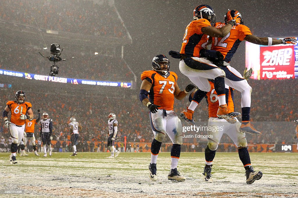 Wide receiver Andre Caldwell #12 of the Denver Broncos celebrates with running back C.J. Anderson #22 of the Denver Broncos after scoring a fourth quarter touchdown against the New England Patriots at Sports Authority Field at Mile High on November 29, 2015 in Denver, Colorado.
