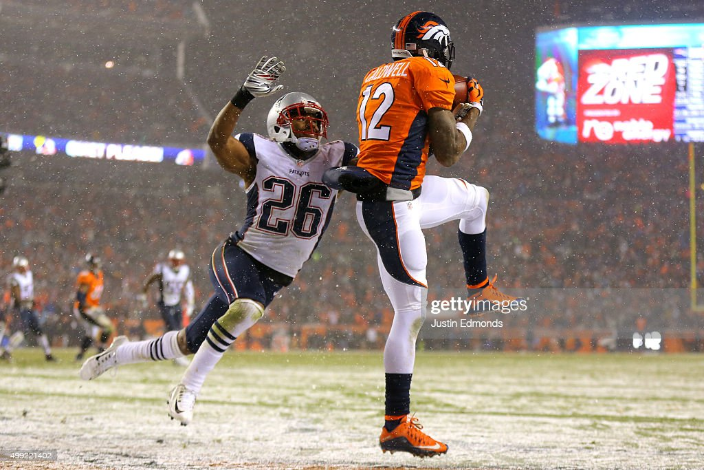Wide receiver Andre Caldwell #12 of the Denver Broncos scores a fourth quarter touchdown past cornerback Logan Ryan #26 of the New England Patriots at Sports Authority Field at Mile High on November 29, 2015 in Denver, Colorado.