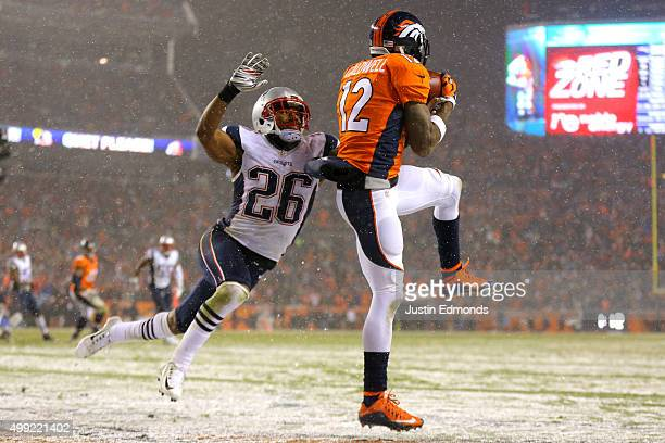 Wide receiver Andre Caldwell of the Denver Broncos scores a fourth quarter touchdown past cornerback Logan Ryan of the New England Patriots at Sports...