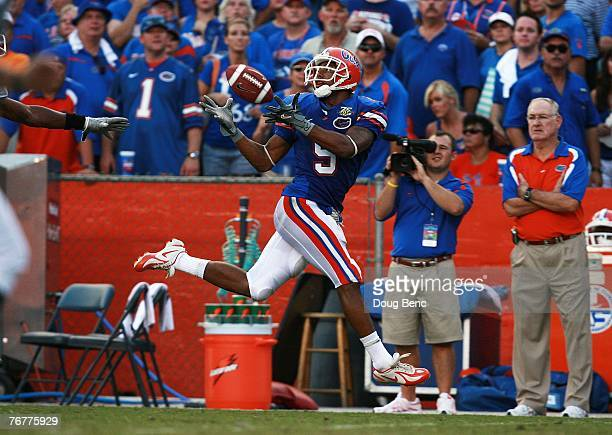Wide receiver Andre Caldwell of the Florida Gators hauls in a long reception late in the fourth quarter against the Tennessee Volunteers at Ben Hill...