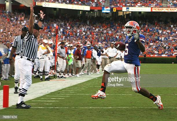 Wide receiver Andre Caldwell of the Florida Gators scores on a touchdown run in the second quarter against the Troy Trojans at Ben Hill Griffin...