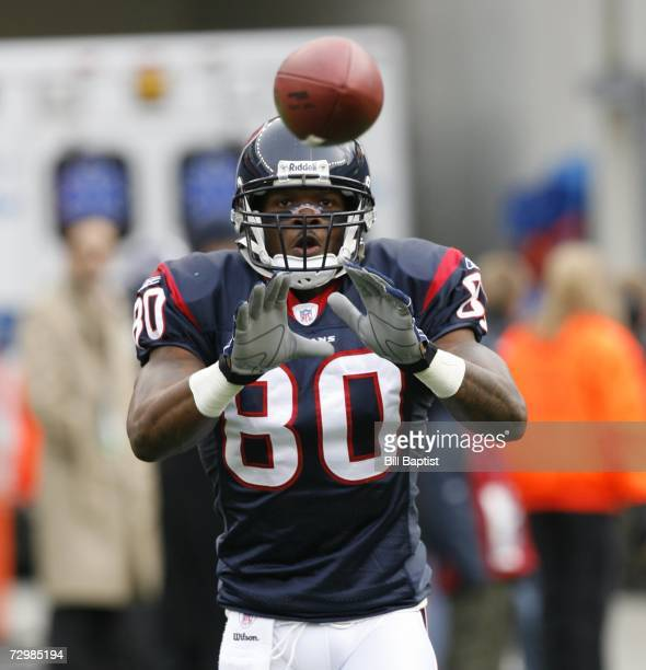 Wide receiver Andre Johnson of the Houston Texans catches a ball before the game against the New England Patriots at Gillette Stadium on December 17...