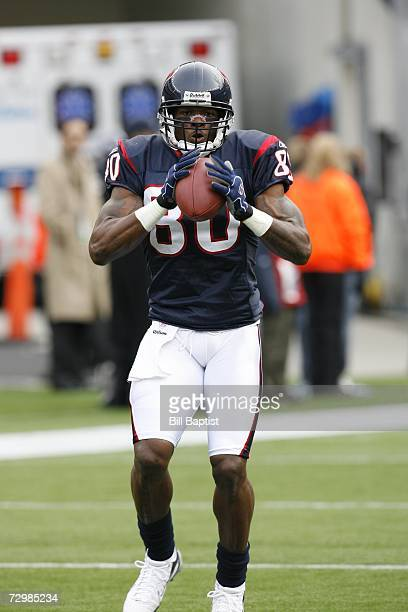 Wide receiver Andre Johnson of the Houston Texans catches a ball during the game against the New England Patriots at Gillette Stadium on December 17...