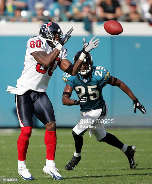 Wide receiver Andre Johnson of the Houston Texans catches a pass in front of cornerback Kenny Wright of the Jacksonville Jaquars on November 6, 2005...