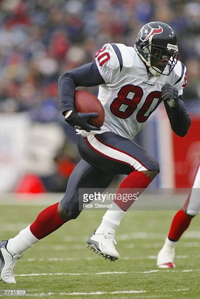 Wide receiver Andre Johnson of the Houston Texans runs after a catch against the Buffalo Bills on November 16 2003 at Ralph Wilson Stadium in Orchard...