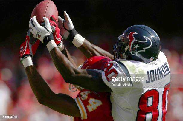 Wide Receiver Andre Johnson the Houston Texans makes a catch over the head of Cornerback Eric Warfield of the Kansas City Chiefs during the 2nd half...
