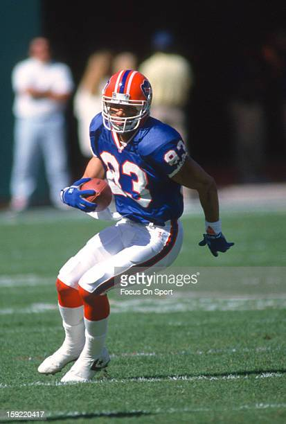 Wide Receiver Andre Reed of the Buffalo Bills looks to put a move on Troy Vincent of the Miami Dolphins during the AFC/NFL Conference Championship...
