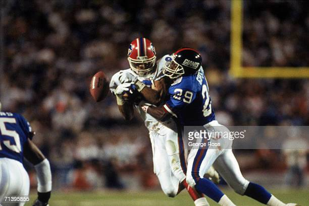Wide receiver Andre Reed of the Buffalo Bills looses the ball after a hit by safety Myron Guyton of the New York Giants in the second quarter of...