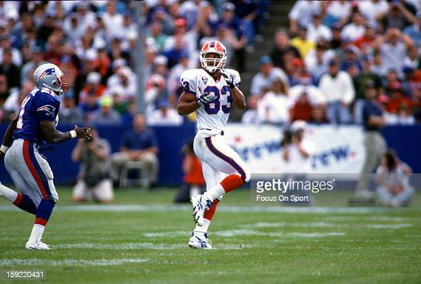 Wide Receiver Andre Reed of the Buffalo Bills runs a pass rout against the New England Patriots during an NFL football game September 11 1994 at...