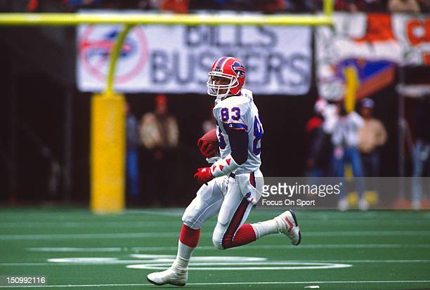 Wide Receiver Andre Reed of the Buffalo Bills runs with the ball after a catch against the Cincinnati Bengals during the AFC/NFL Conference...
