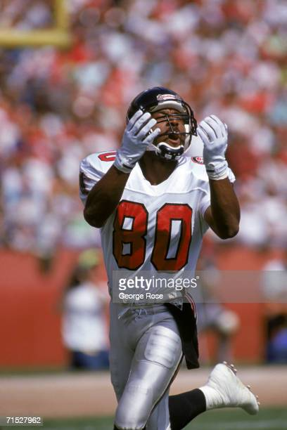 Wide receiver Andre Rison of the Atlanta Falcons reaches out his arms as he attempts to catch the ball during a game against the San Francisco 49ers...
