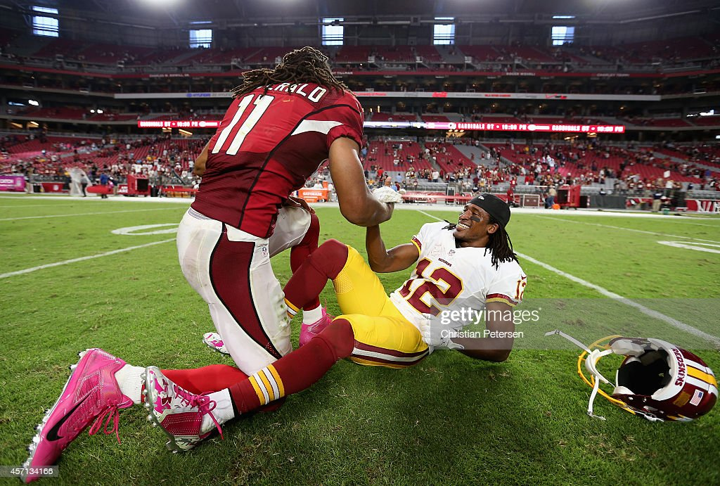 Wide receiver Andre Roberts #12 of the Washington Redskins jokes around with Larry Fitzgerald #11 of the Arizona Cardinals following the NFL game at the University of Phoenix Stadium on October 12, 2014 in Glendale, Arizona. The Cardinals defeated the Redskins 30-20.