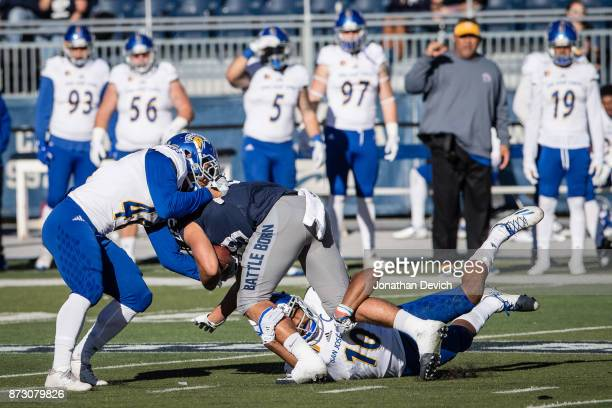 Wide receiver Andrew Celis of the Nevada Wolf Pack is taken down during a play against the San Jose State Spartans at Mackay Stadium on November 11...