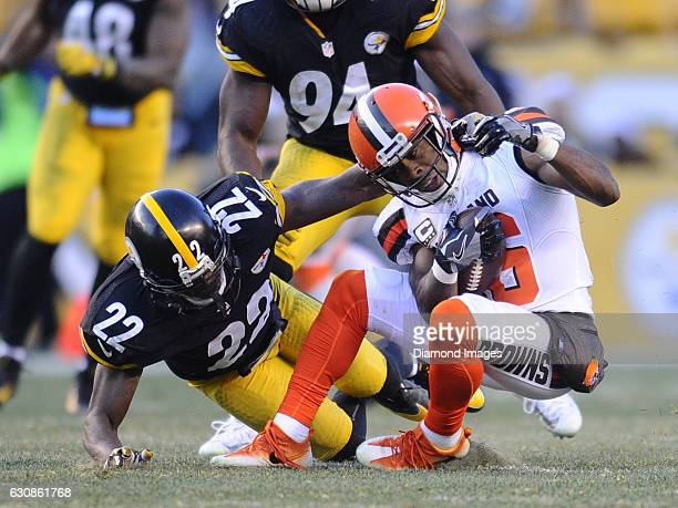 Wide receiver Andrew Hawkins of the Cleveland Browns is tackled by cornerback William Gay of the Pittsburgh Steelers during a game on January 1 2017...
