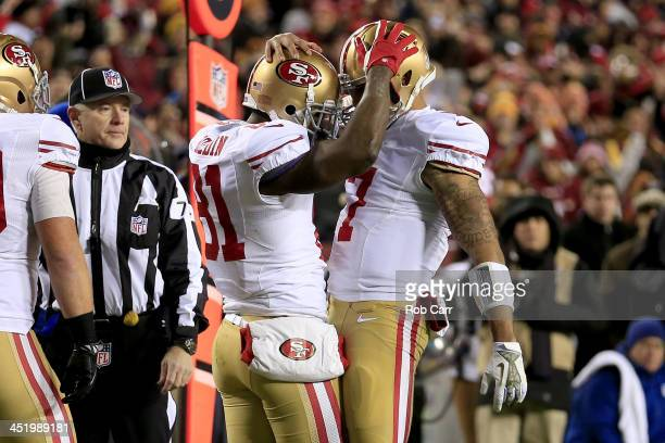 Wide receiver Anquan Boldin and quarterback Colin Kaepernick of the San Francisco 49ers celebrate after Boldin catches a 19yard touchdown in the...