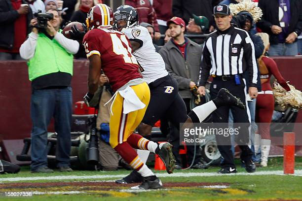 Wide receiver Anquan Boldin of the Baltimore Ravens catches a touchdown pass in front of free safety Madieu Williams of the Washington Redskins...