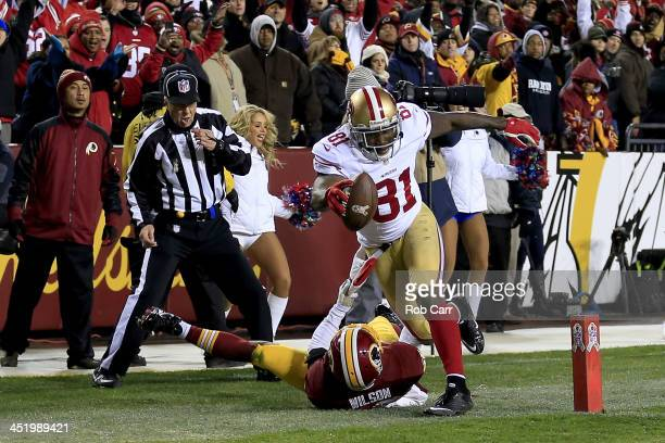 Wide receiver Anquan Boldin of the San Francisco 49ers catches a 19yard touchdown against cornerback Josh Wilson of the Washington Redskins in the...