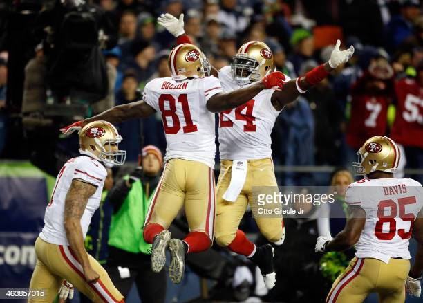 Wide receiver Anquan Boldin of the San Francisco 49ers celebrates with running back Anthony Dixon after Boldin makes a 26-yard touchdown catch...