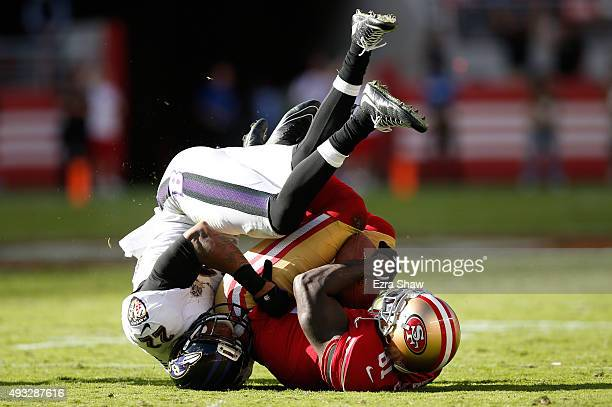 Wide receiver Anquan Boldin of the San Francisco 49ers makes a catch against cornerback Jimmy Smith of the Baltimore Ravens during their NFL game at...