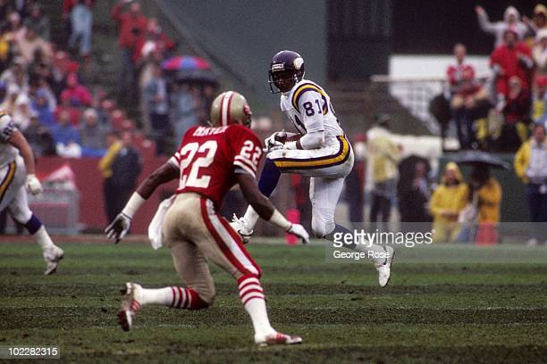 Wide receiver Anthony Carter of the Minnesota Vikings as corberback Tim McKyer of the San Francisco 49ers closes in during the 1987 NFC Divisional...