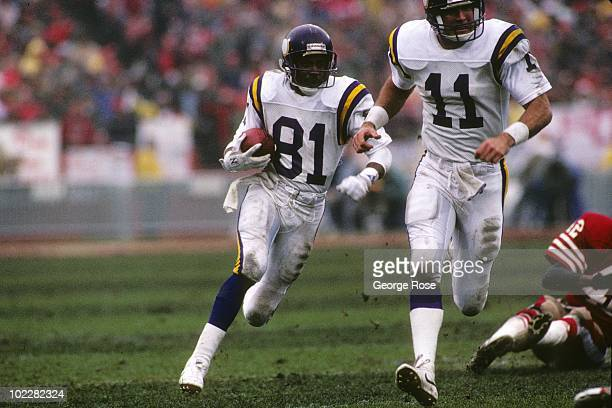 Wide receiver Anthony Carter of the Minnesota Vikings follows teammate Wade Wilson during the 1987 NFC Divisional Playoffs against the San Francisco...