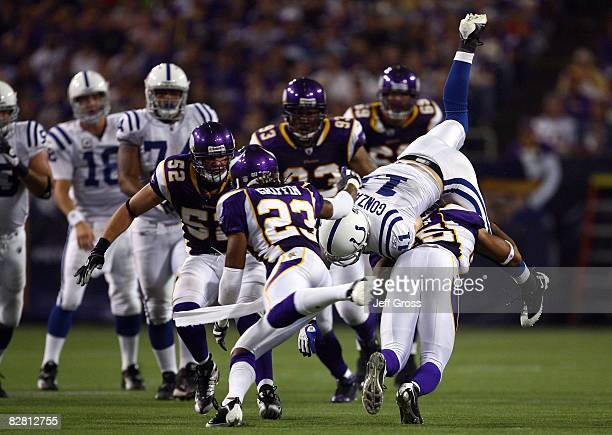 Wide receiver Anthony Gonzalez of the Indianapolis Colts is tackled by Tyrell Johnson of the Minnesota Vikings in the fourth quarter at the Metrodome...