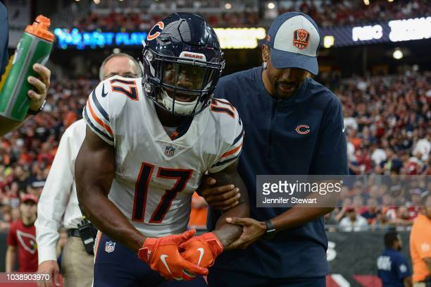 Wide receiver Anthony Miller of the Chicago Bears helped off the field after an injury in the second half of the NFL game against the Arizona...
