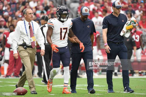 Wide receiver Anthony Miller of the Chicago Bears is walked off the field after an injury in the first half against the Arizona Cardinals during the...