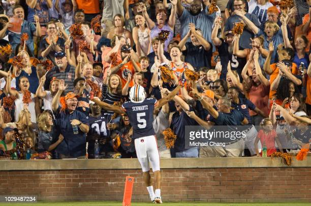 Wide receiver Anthony Schwartz of the Auburn Tigers celebrates with fans after scoring a touchdown in the first half during their game against the...