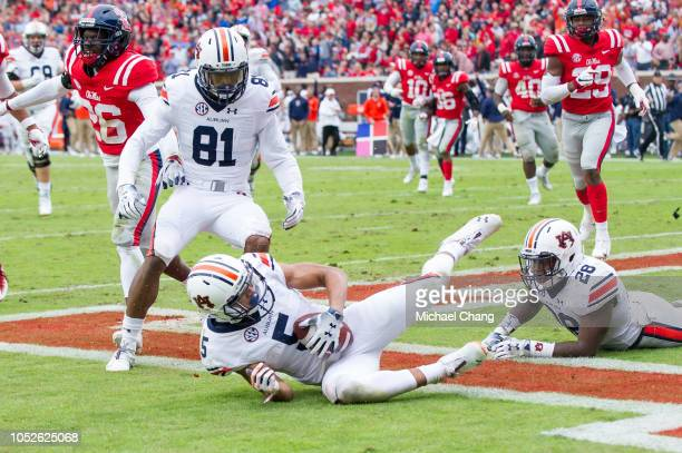 Wide receiver Anthony Schwartz of the Auburn Tigers recovers a fumble in the end zone for a touchdown during the first quarter of their game against...