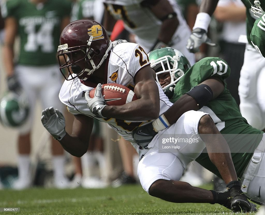 Wide receiver Antonio Brown #27 of the Central Michigan Chippewas is tackled by linebacker Chris Norman #10 of the Michigan State Spartans in the first quarter at Spartan Stadium on September 12, 2009 in East Lansing, Michigan. Central Michigan won the game 29-27.