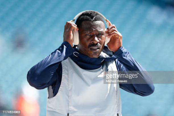 Wide Receiver Antonio Brown of the New England Patriots warms up prior to the game against the Miami Dolphins at Hard Rock Stadium on September 15...