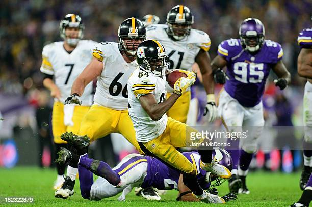 Wide receiver Antonio Brown of the Pittsburgh Steelers beats cornerback Josh Robinson of the Minnesota Vikings during the NFL International Series...